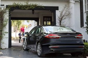 2020 Ford Fusion Plug-in Hybrid being charged from rear drivers side