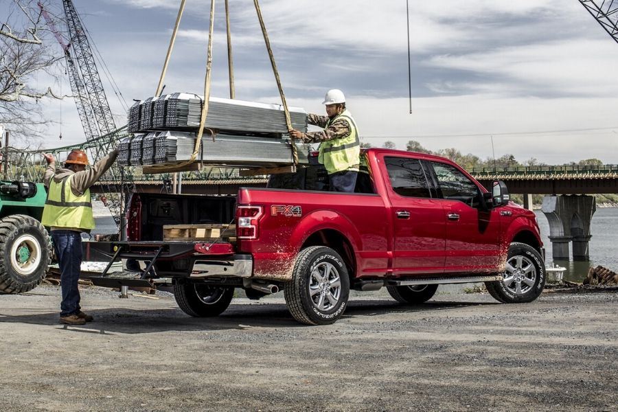 Construction workers loading Ford F-150