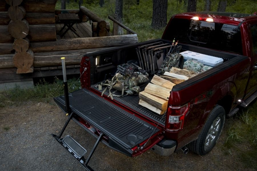 Top view of Ford F-150 BoxLink bed with wood and hunting gear inside_o