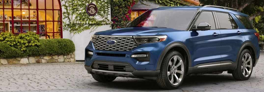 2020 Ford Explorer front fascia and driver side on cobblestone in front of shop with hedges