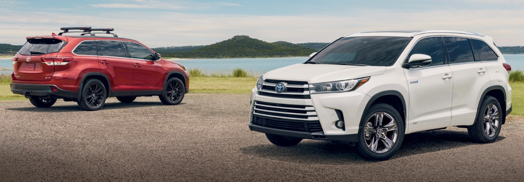 two 2019 toyota highlanders parked