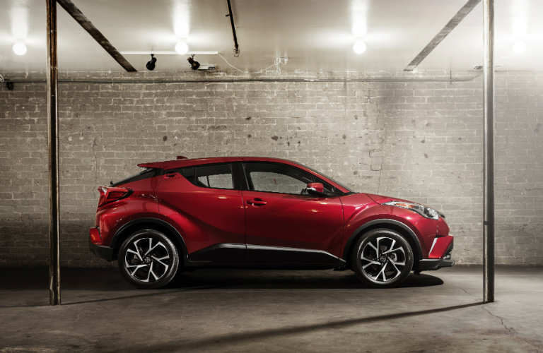Profile view of red 2018 Toyota C-HR parked inside garage