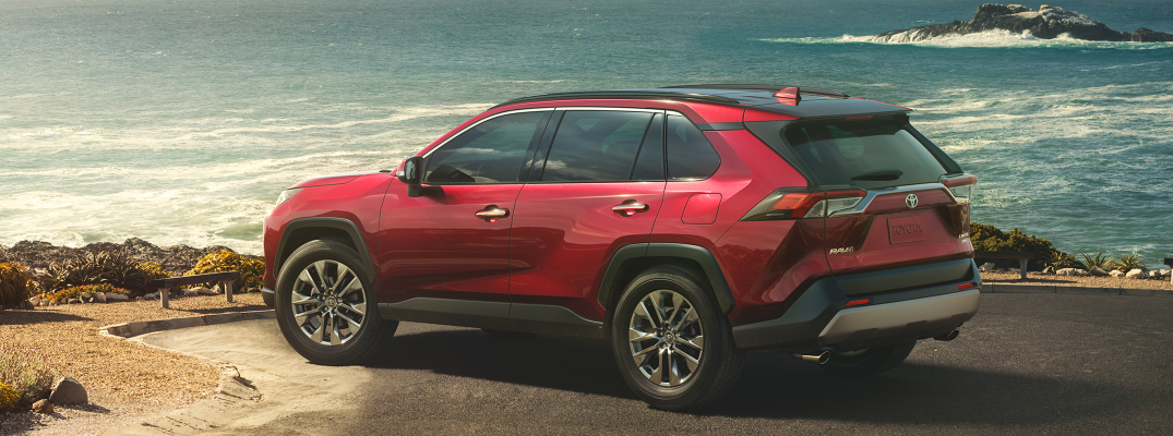 Profile view of 2019 Toyota RAV4 parked on waterfront in daytime