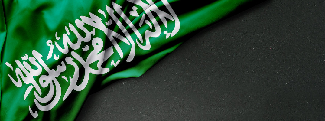 Folded flag of Saudi Arabia on black background