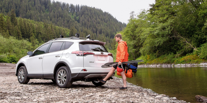 Man using foot to activate rear power liftgate of 2018 Toyota RAV4