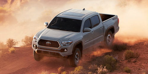 Front view of 2018 Toyota Tacoma driving over hill