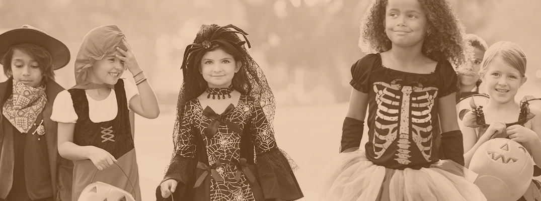 sepia image of five kids in halloween constumes
