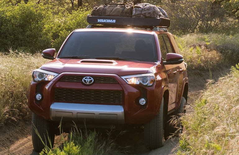 Front grille of red 2019 Toyota 4Runner with cargo on top