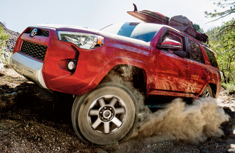 Red 2019 Toyota 4Runner driving through sand