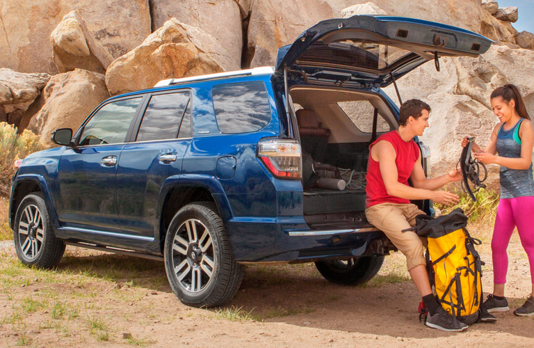 Two people loading cargo in rear area of 2019 Toyota 4Runner