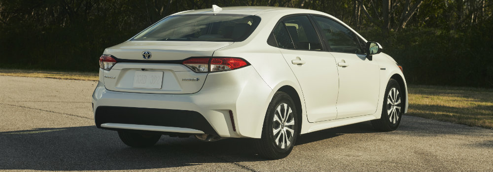 Rear view of 2020 Toyota Corolla Hybrid driving on parkway