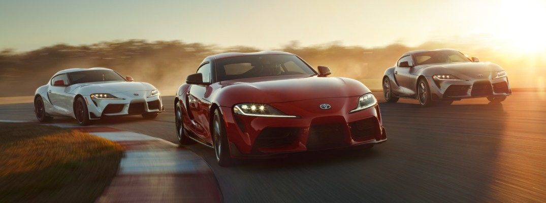 Three 2020 Toyota Supra models driving on track
