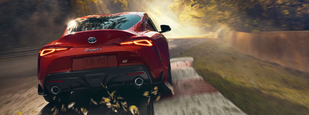 Rear shot of 2020 Toyota Supra driving down track
