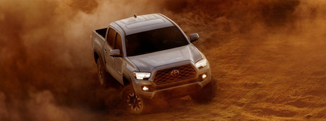 Overhead view of 2020 Toyota Tacoma driving through sand