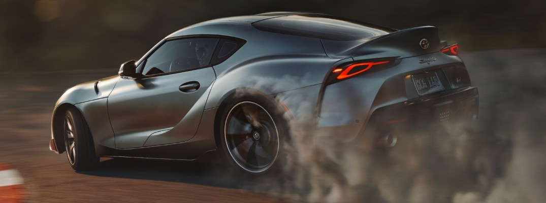 Rear profile view of 2020 Toyota Supra GR driving on track