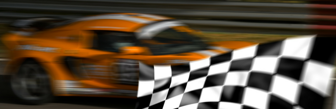 generic race car speeding by a checkered flag