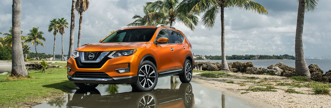 2019 Nissan Rogue parked near palm trees
