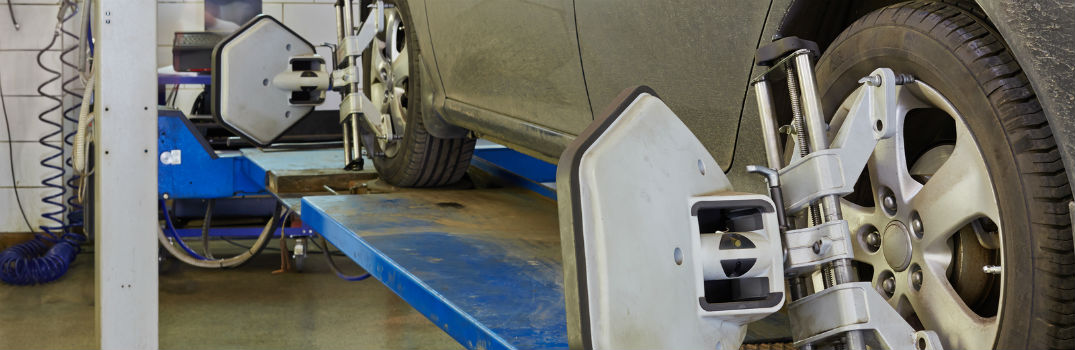 vehicle on a hoist getting a wheel alignment