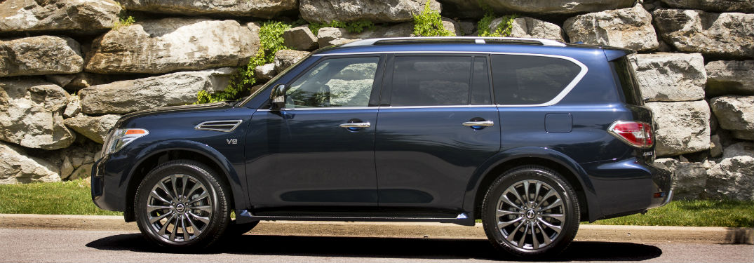 2020 Nissan Armada exterior driver side parked in front of rock wall