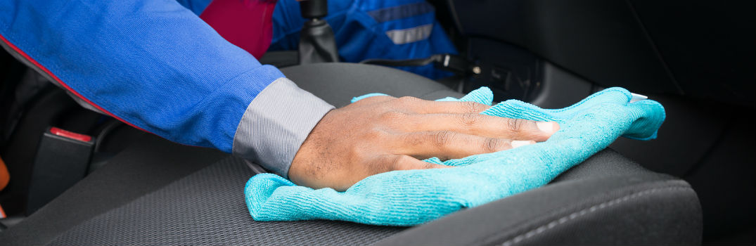 person wiping down car seats with cloth_b