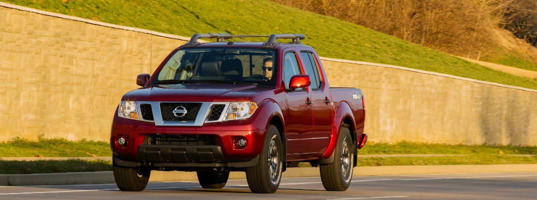 A head-on photo of the 2020 Nissan Frontier on the road.