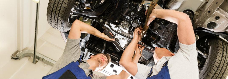 two men working under car