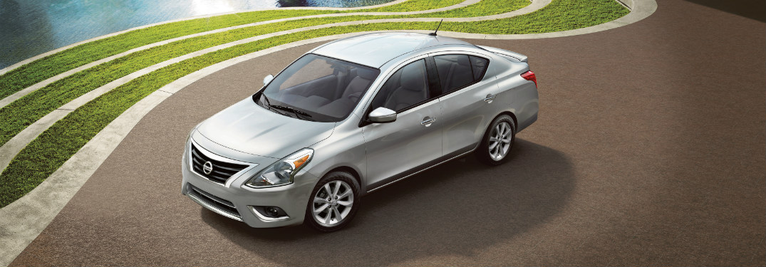 front and side view of silver 2018 nissan versa