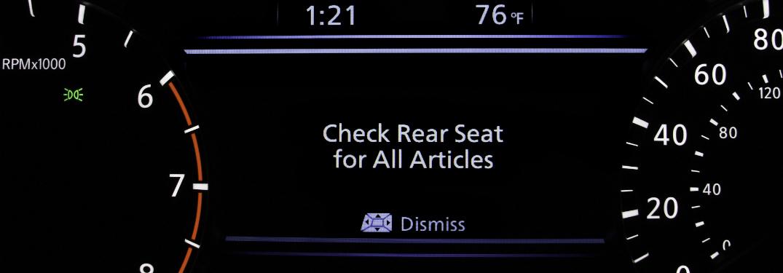 nissan rear door alert technology notification on driver's dashboard