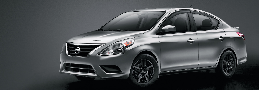 front and side view of silver 2019 nissan versa