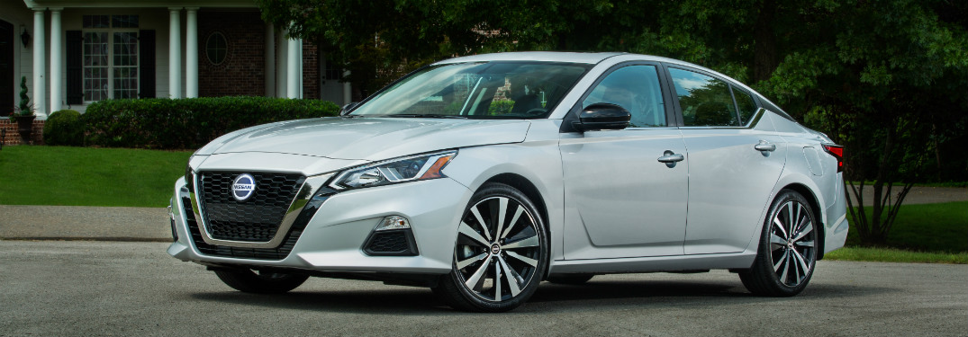 front and side view of white 2019 nissan altima