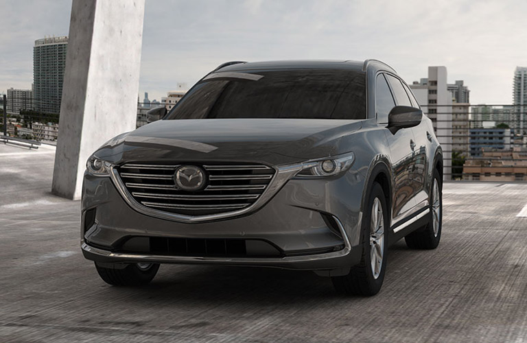 2018 Gray Mazda CX 9 Parked In Parking Structure With City Skyline In  Background