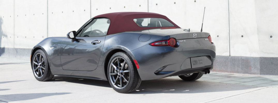 Exterior view of a silver 2018 Mazda MX-5 Miata parked against a white and gray wall