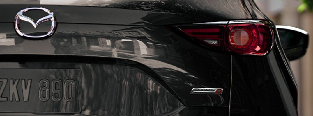 Closeup view of the SKYACTIV®-D badge on the rear of a gray 2019 Mazda CX-5 Signature Diesel