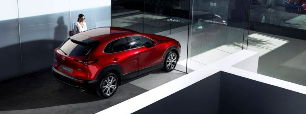Exterior view of a red 2020 Mazda CX-30 parked in a driveway
