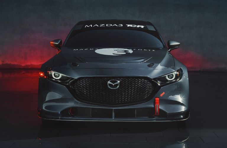 Exterior view of the front of the gray Mazda3 TCR