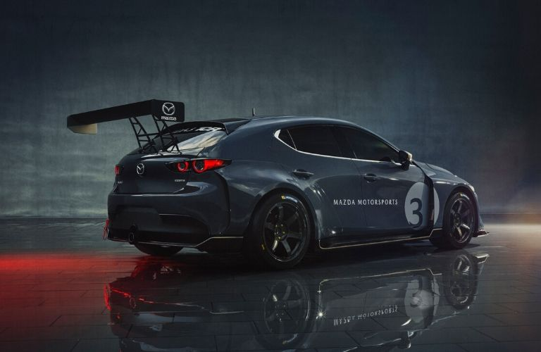 Exterior view of the rear passenger's side of the gray Mazda3 TCR