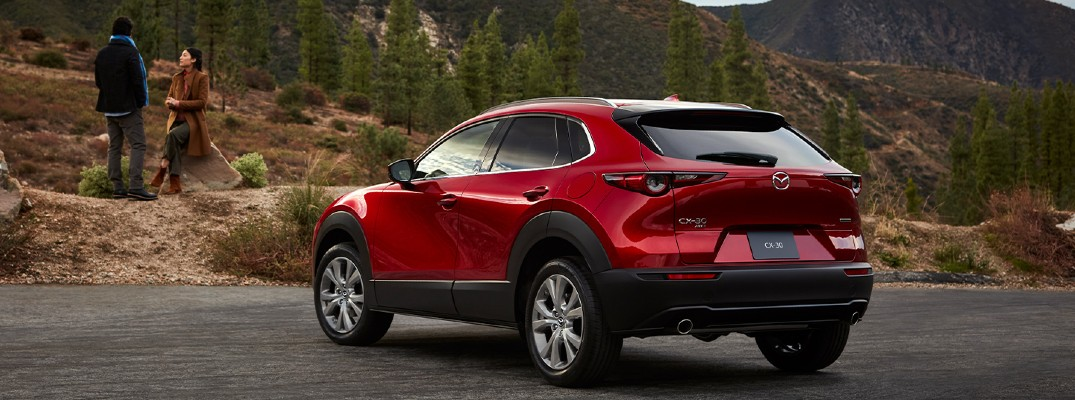 2020 Mazda CX-30 red paint parked by mountain forest trail view of back end and asphalt resized