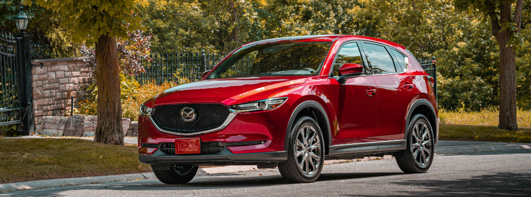 A front left quarter photo of the 2020 Mazda CX-5 parked on the street.