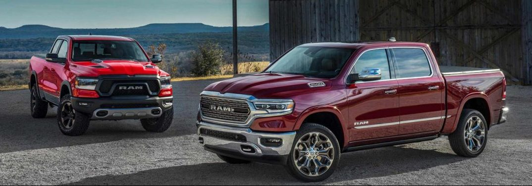 two 2019 RAM 1500 models parked next to each other