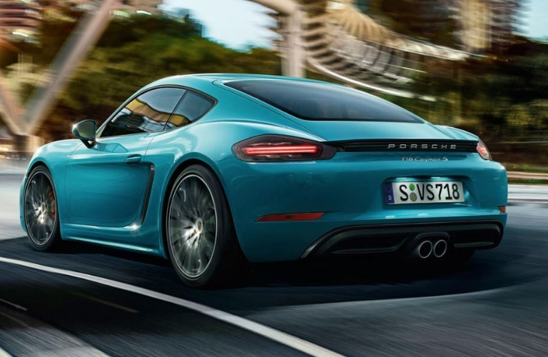 2019 Porsche 718 Cayman rear view on road
