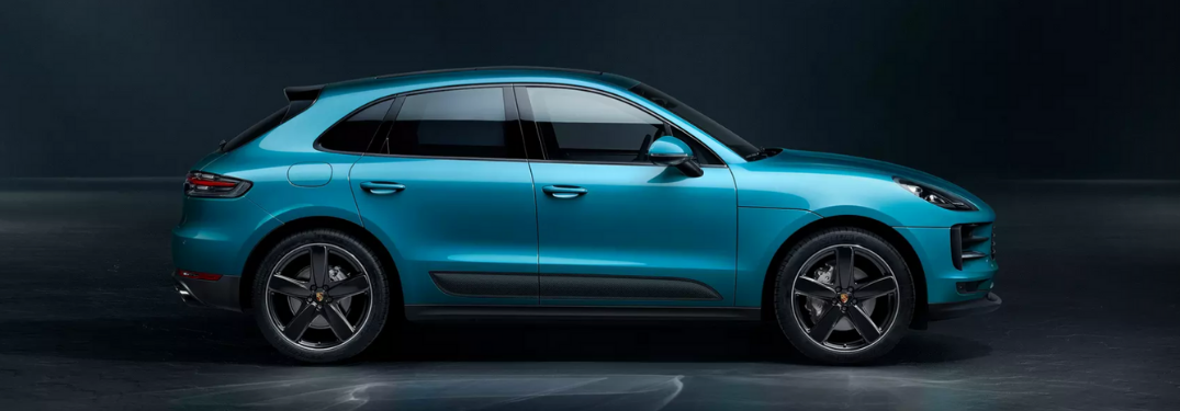 2019 Porsche Macan parked in darkness side view