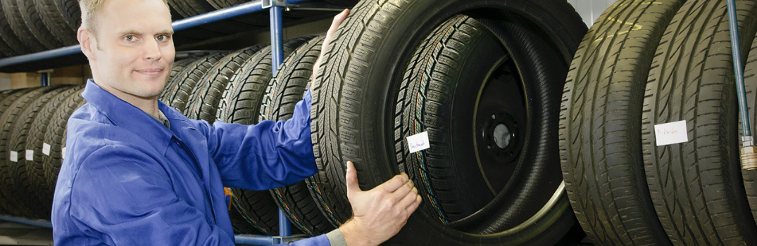 Technician holding a tire
