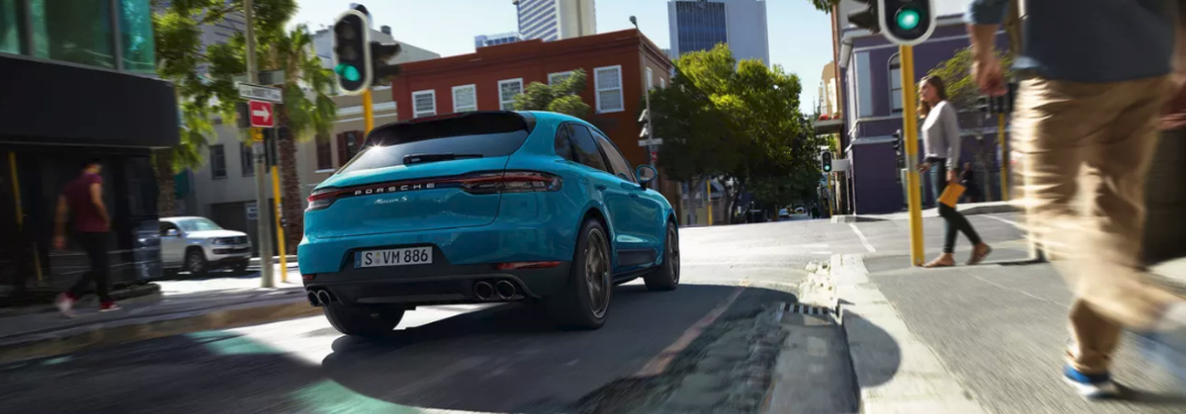 2019 Porsche Macan driving on a road