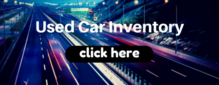 Used car inventory click here heading and a highway at night