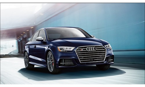 2018 Audi S3 exterior front shot with dark blue color paint job driving through a blue tunnel