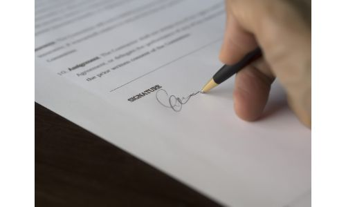 Hand signing some papers