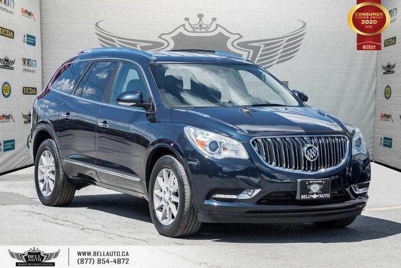 Exterior view of a black Buick Enclave in the Bell Auto Inc showroom