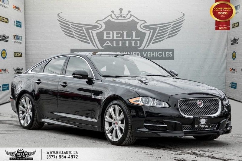 Exterior view of a black 2015 Jaguar XJ in the Bell Auto Inc showroom