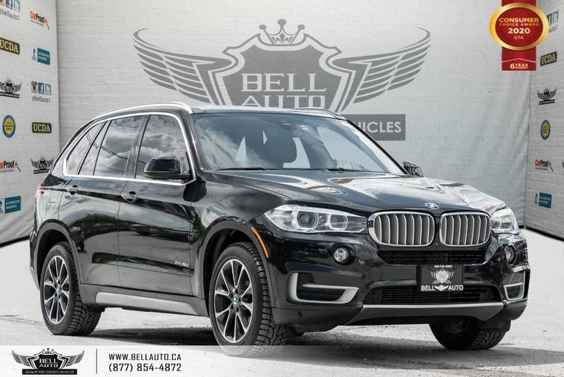 Exterior view of a black 2016 BMW X5 xDrive35 in the Bell Auto Inc showroom