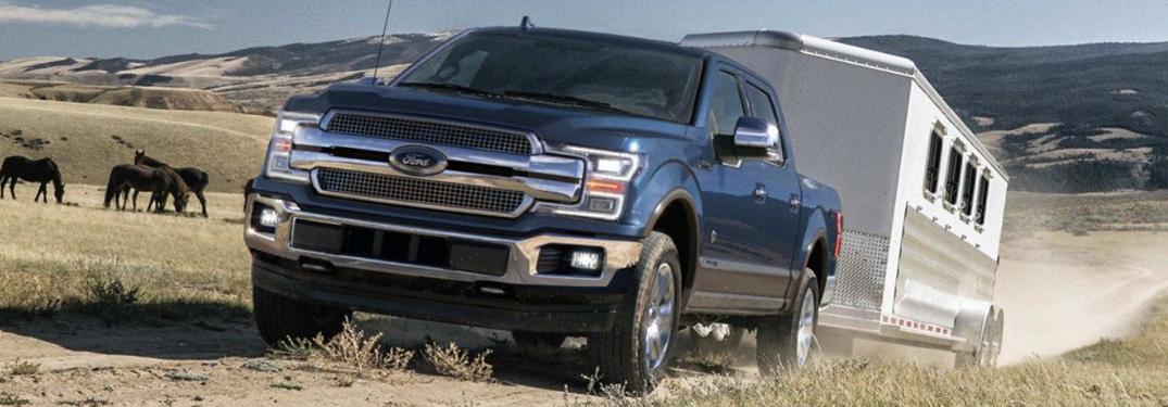 2019 Ford F-150 driving on a dirt road